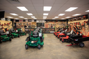 a wide shot of the showroom inside the ASC Lawn Equipment building